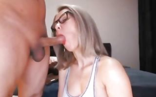 Blonde babe is smoking a cigarette while she is blowing his huge cock